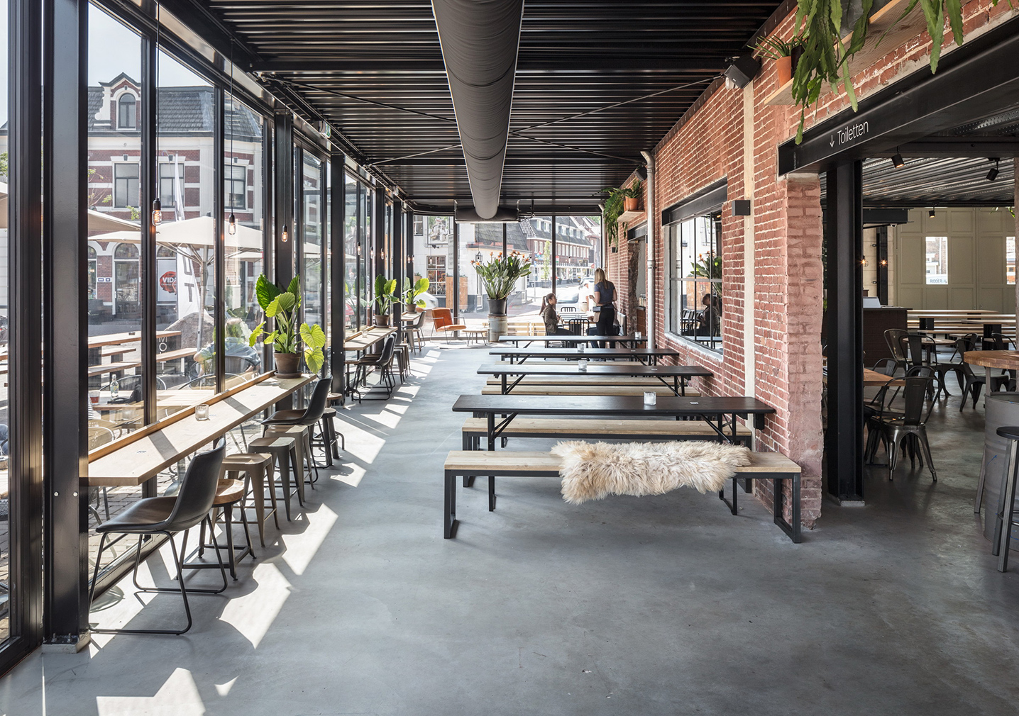 Former garage is reborn as Mout Foodhall in Holland's Hilversum