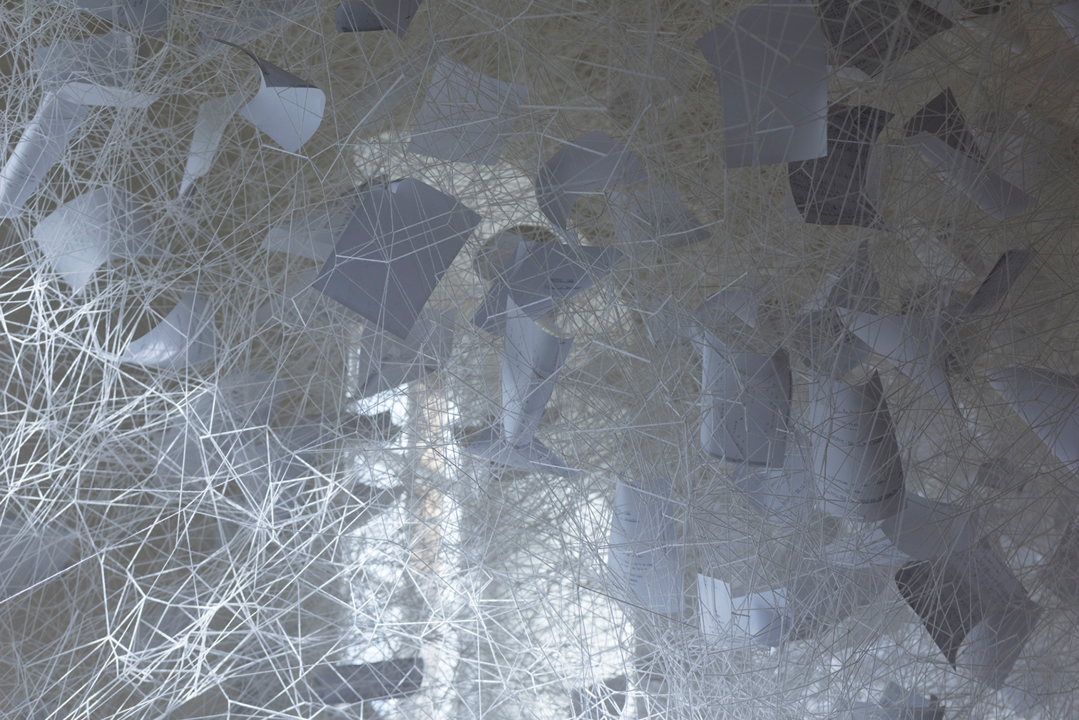 Chiharu Shiota, Beyond Time, 2018. White thread, metal piano, musical notes. (c) VG Bild- Kunst, Bonn, 2018 and the artist. Courtesy Yorkshire Sculpture Park. Photography: Jonty Wilde