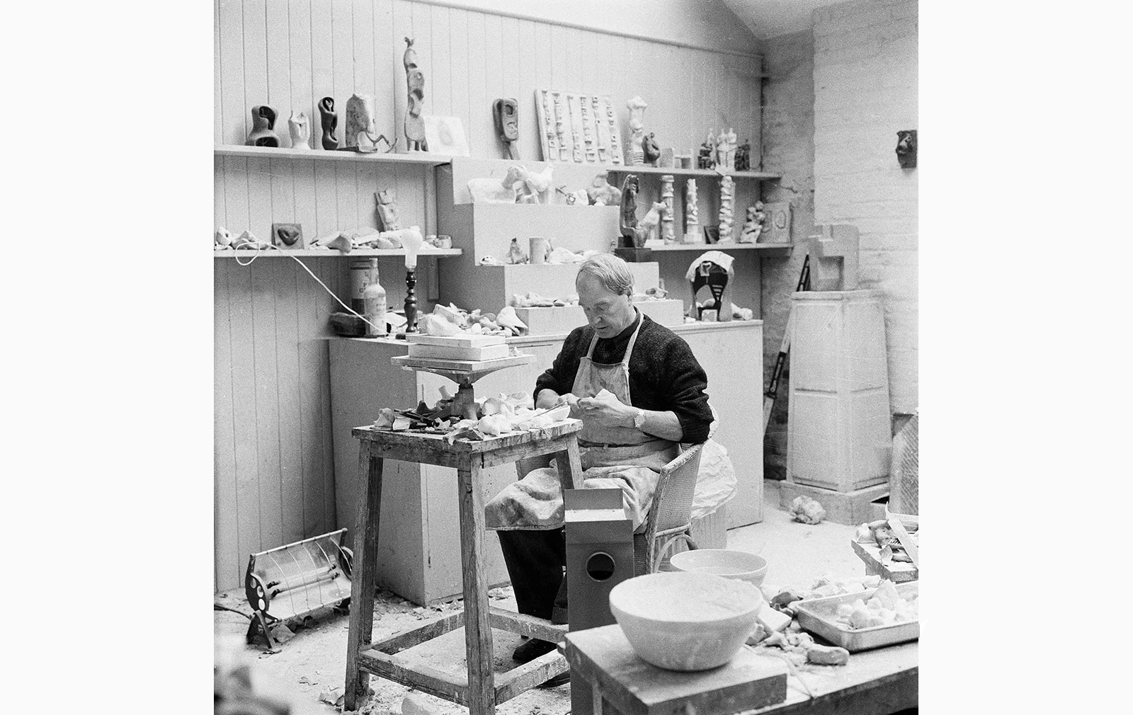 Henry Moore working on a plaster in his Maquette Studio, Perry Green, c. 1960. Photography: John Hedgecoe. Reproduced by permission of The Henry Moore Foundation for the Wunderkammer: Origins of Form exhibition at Gagosian