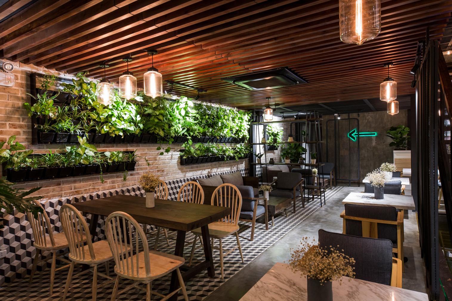 Le House designs a 'secret garden' cafe in Hanoi