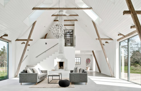 A ruined barn is revived as a minimalist country retreat in Sweden
