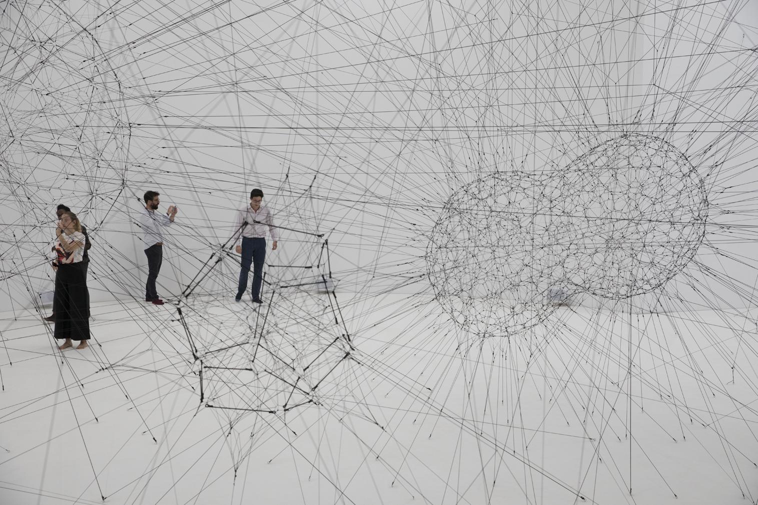 Tomás Saraceno spins a 'cosmic' spiderweb inside Paris' Palais de Tokyo