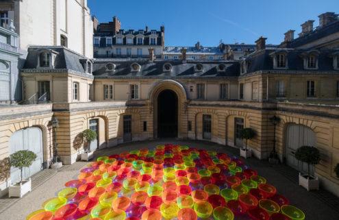 Artist Liz West sets a Parisian courtyard aglow