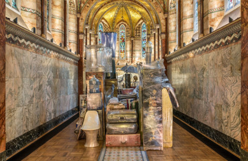 Artist fills London chapel with 200 shrink-wrapped household objects