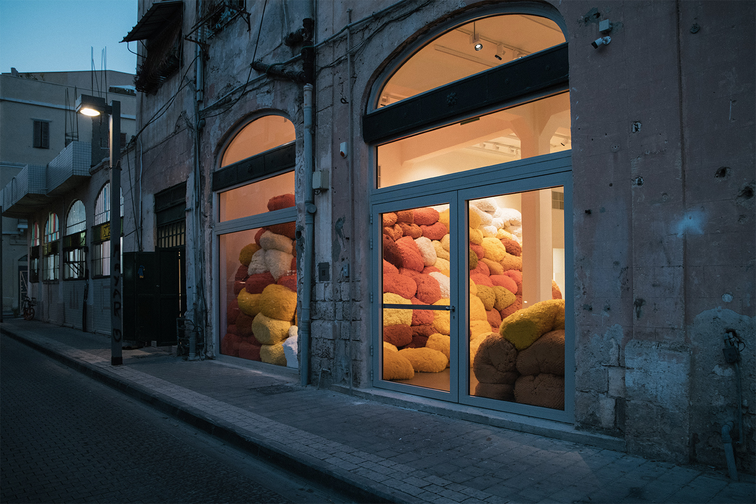 Sheila Hicks installs kaleidoscopic cotton sculptures inside Jaffa's Magasin III gallery