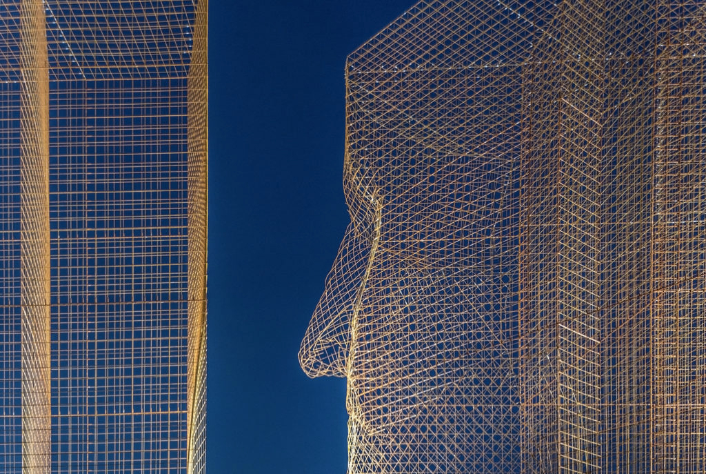 Giant faces watch over Barcelona in Edoardo Trisoldi's latest installation