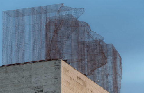 Ghostly faces loom over Barcelona in Edoardo Trisoldi's latest installation