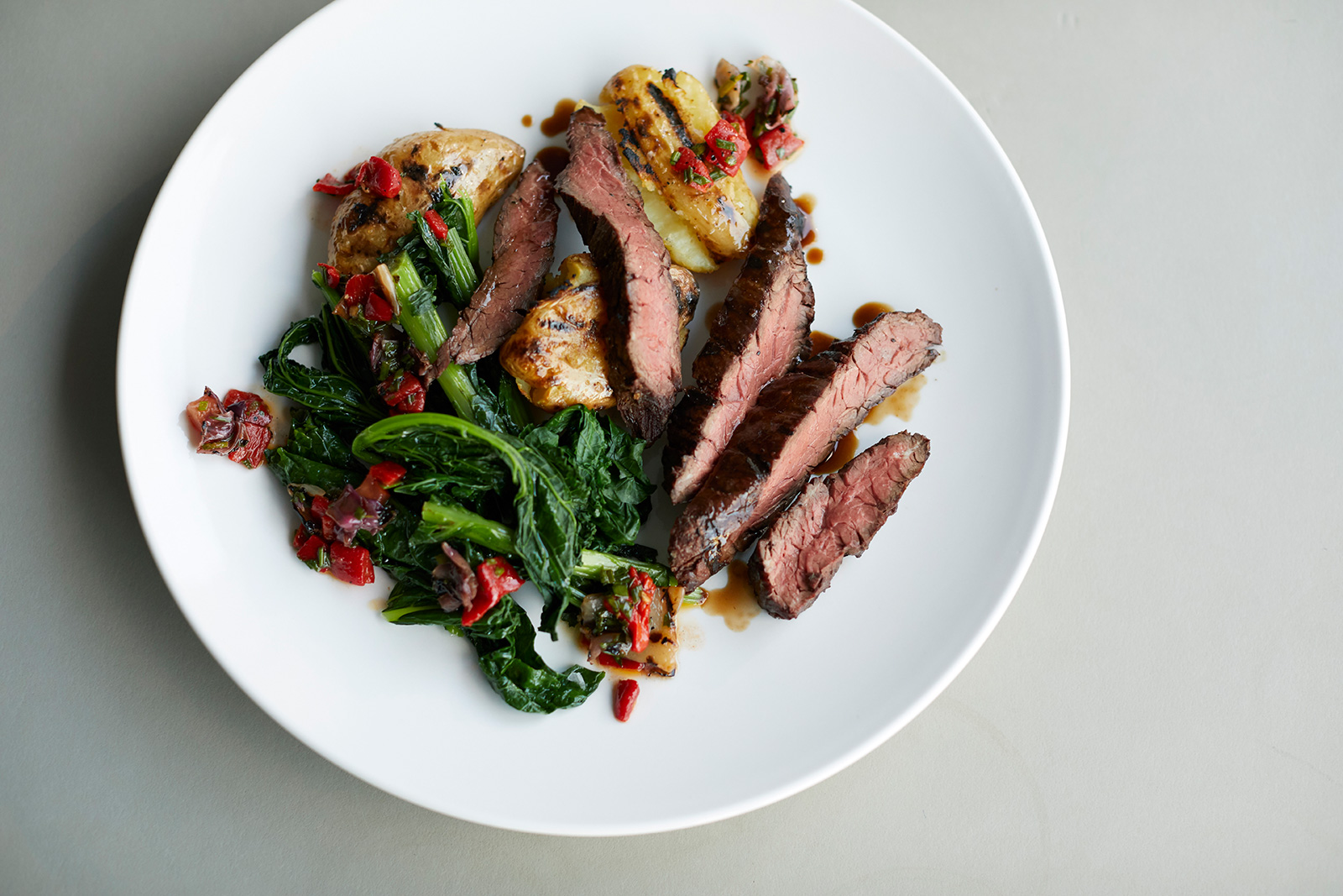 Lamb rump with celeriac, almonds, skordalia and braised chard. Photography: Lucy Richards