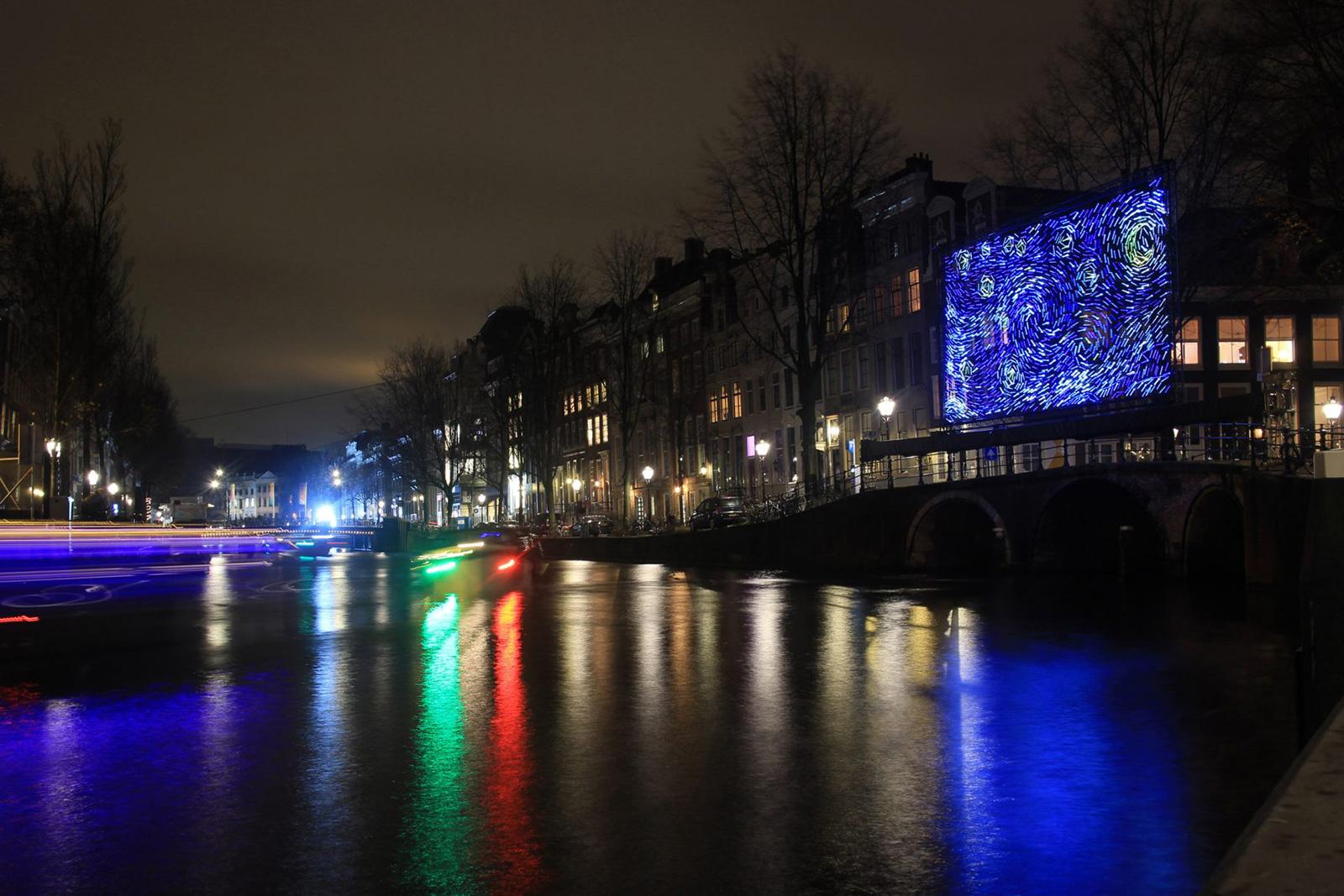 Van Gogh's Starry Night illuminates an Amsterdam bridge