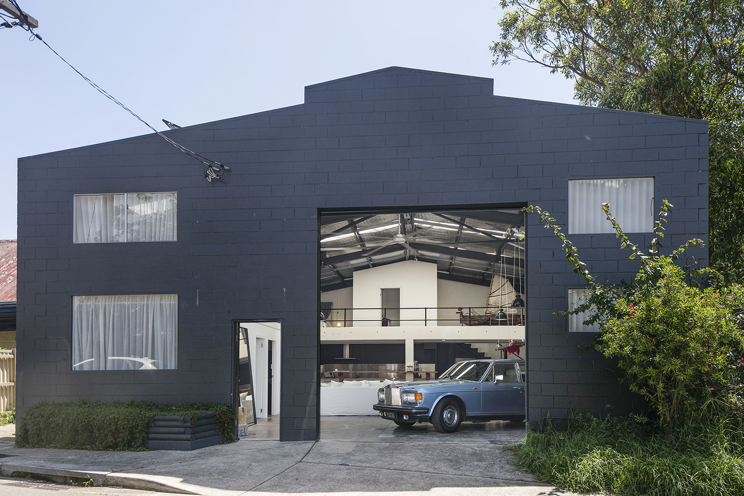 A raw live/work warehouse is headed for auction in Sydney