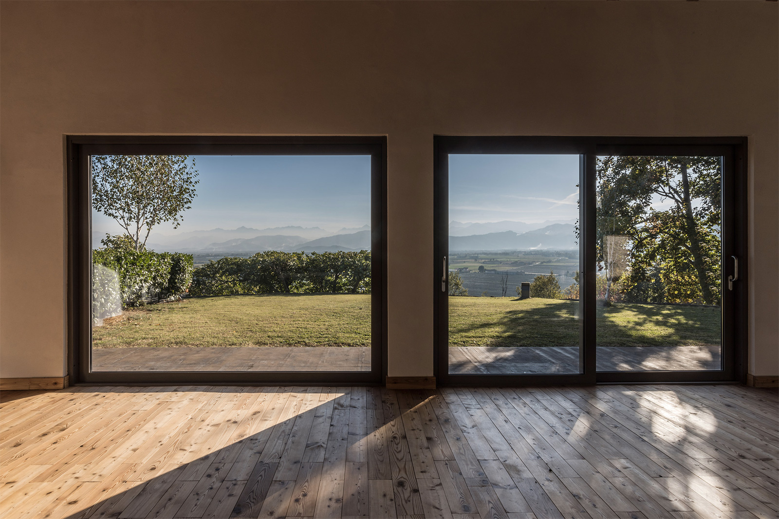 Villa con Vista: a simple interior palette of white walls and raw timber floors doesn't detract from the views