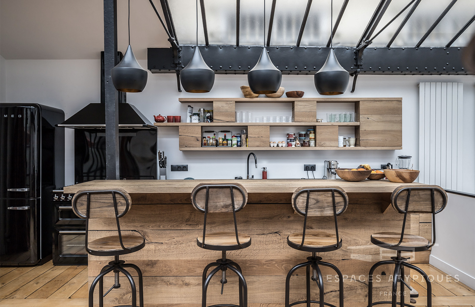 The kitchen fuses industrial and rustic elements
