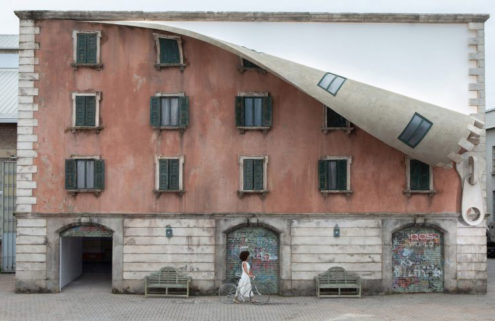Alex Chinneck has unzipped the front of a Milan building