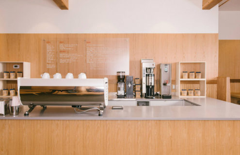 Ultra-muted cafe takes over former auto shop in British Columbia