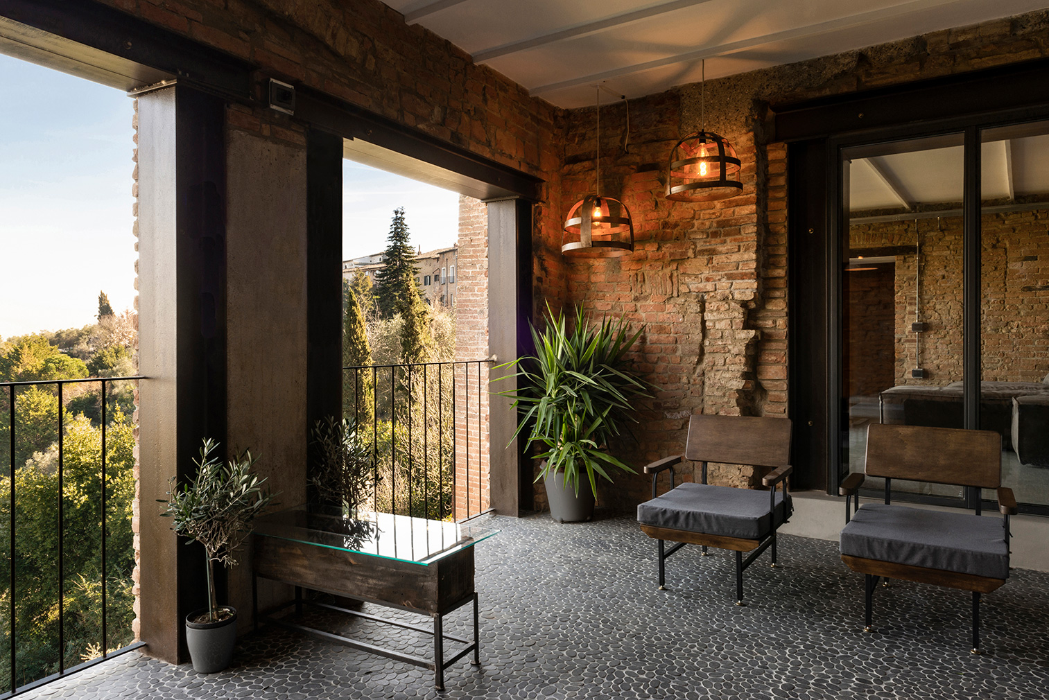 Pebbled floors and red brick walls are on show in the shaded balcony area