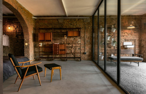 A Tuscan stable is reborn as an industrial loft with a secret swimming pool