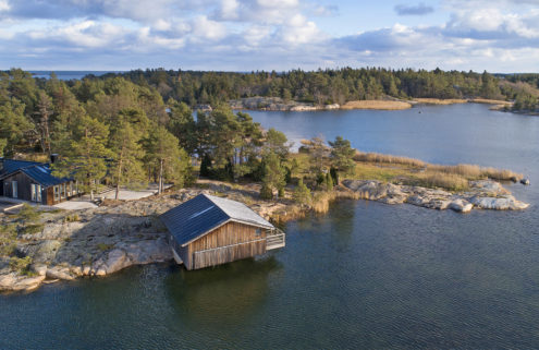 This cabin-like home in Sweden comes with its own island