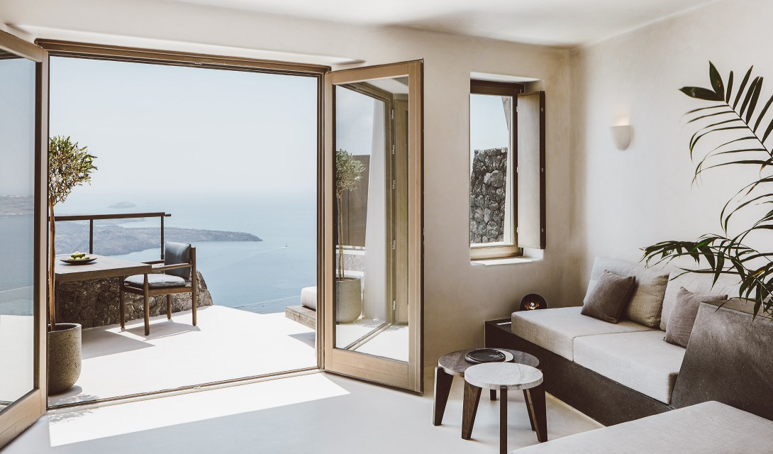 Villa Vora is an angular retreat carved into a volcanic clifftop in Santorini