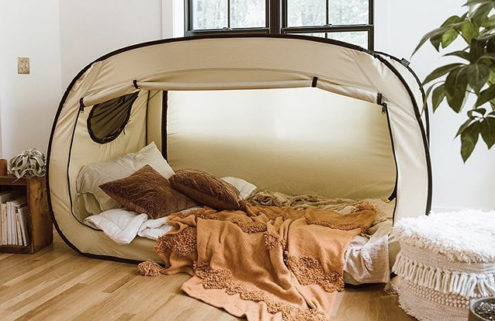 This bed tent offers the ultimate indoor glamping experience