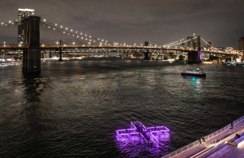 A glowing cross is floating on Manhattan's East River