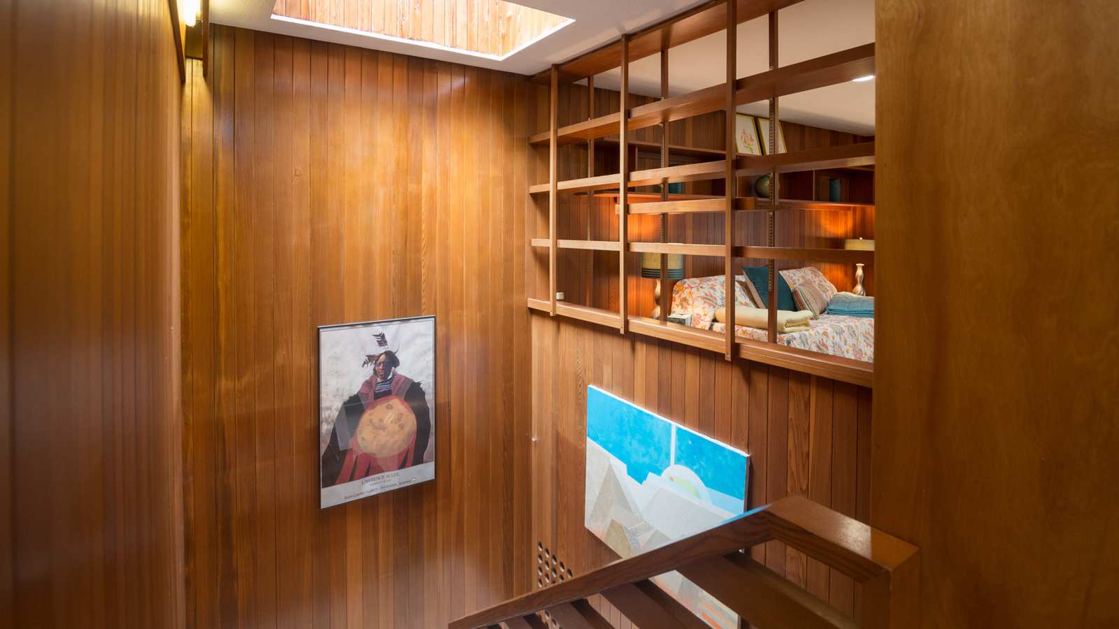 Warm wood panelling is used throughout the Tivadar and Dorothy Balogh House and the stairwell is illuminated by a rectangular skylight