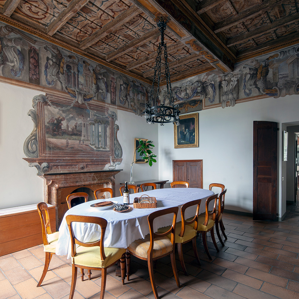 Vilal Berle's dining room featured painted ceilings and walls friezes as well as a restored marble and stone fireplace