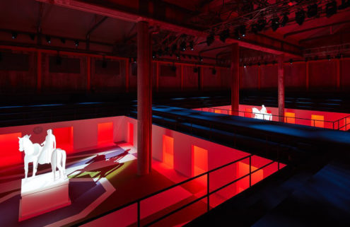 AMO turns Prada's Desposito Hall into a pair of fictional piazzas for FW20 Men's show