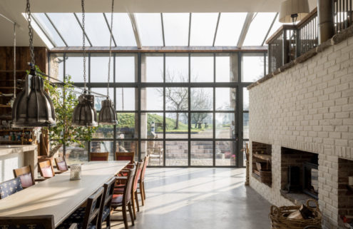Glass walls illuminate this epic barn conversion in Frome, Somerset