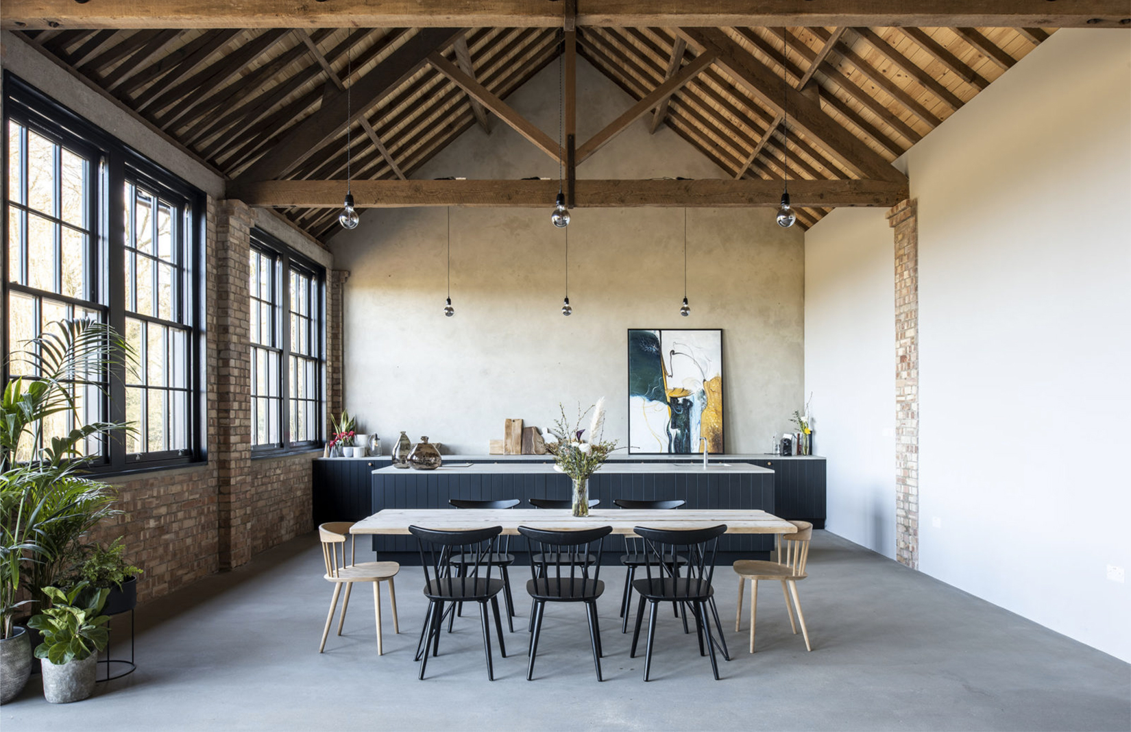 Masterfully converted in the Suffolk Countryside is this former diary barn which features trussed ceilings, bricks and concrete floors