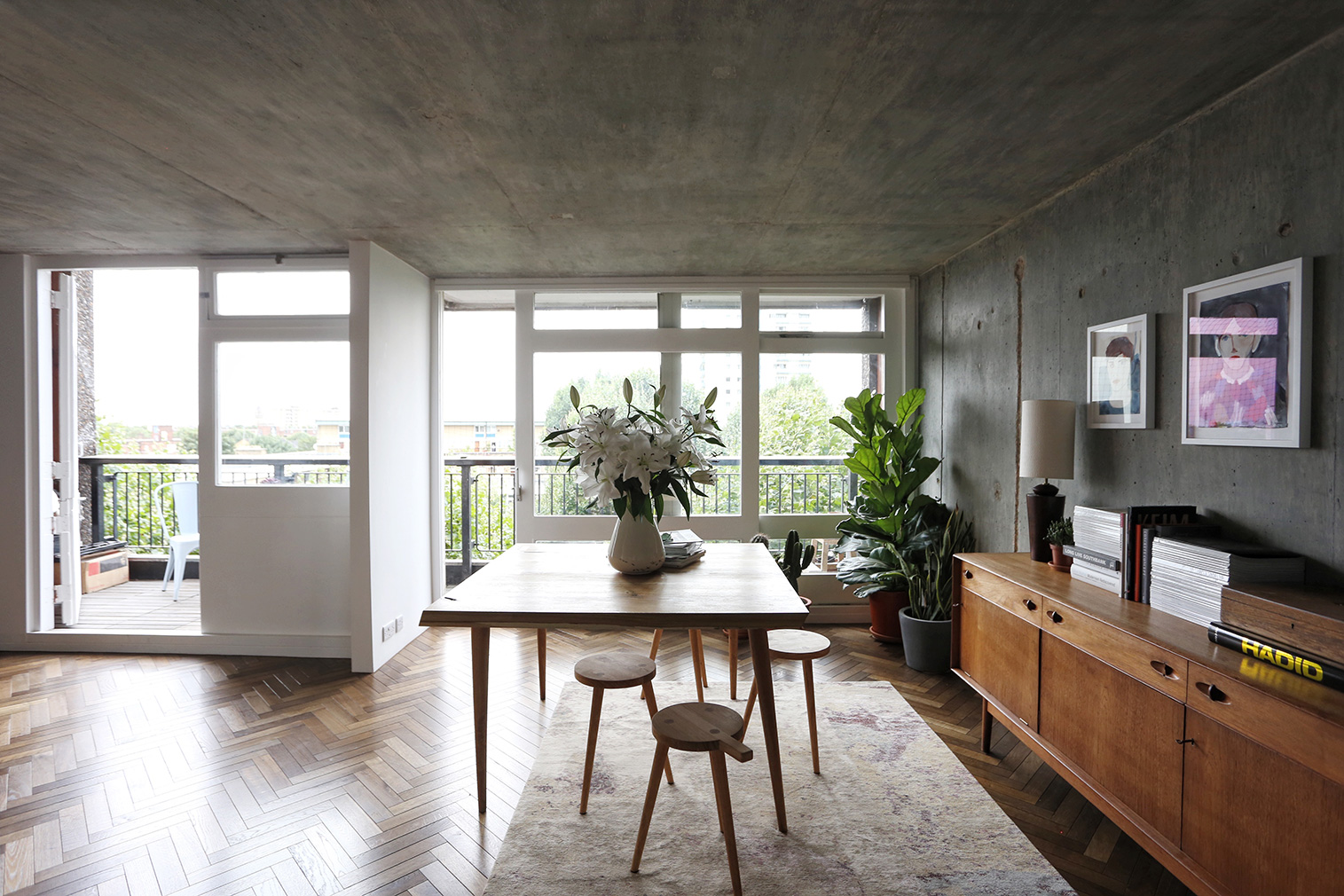 Industrial style is elevated with polished timber and steel in this London apartment, which lies in Ernö Goldfinger's brutalist icon Trellick Tower.