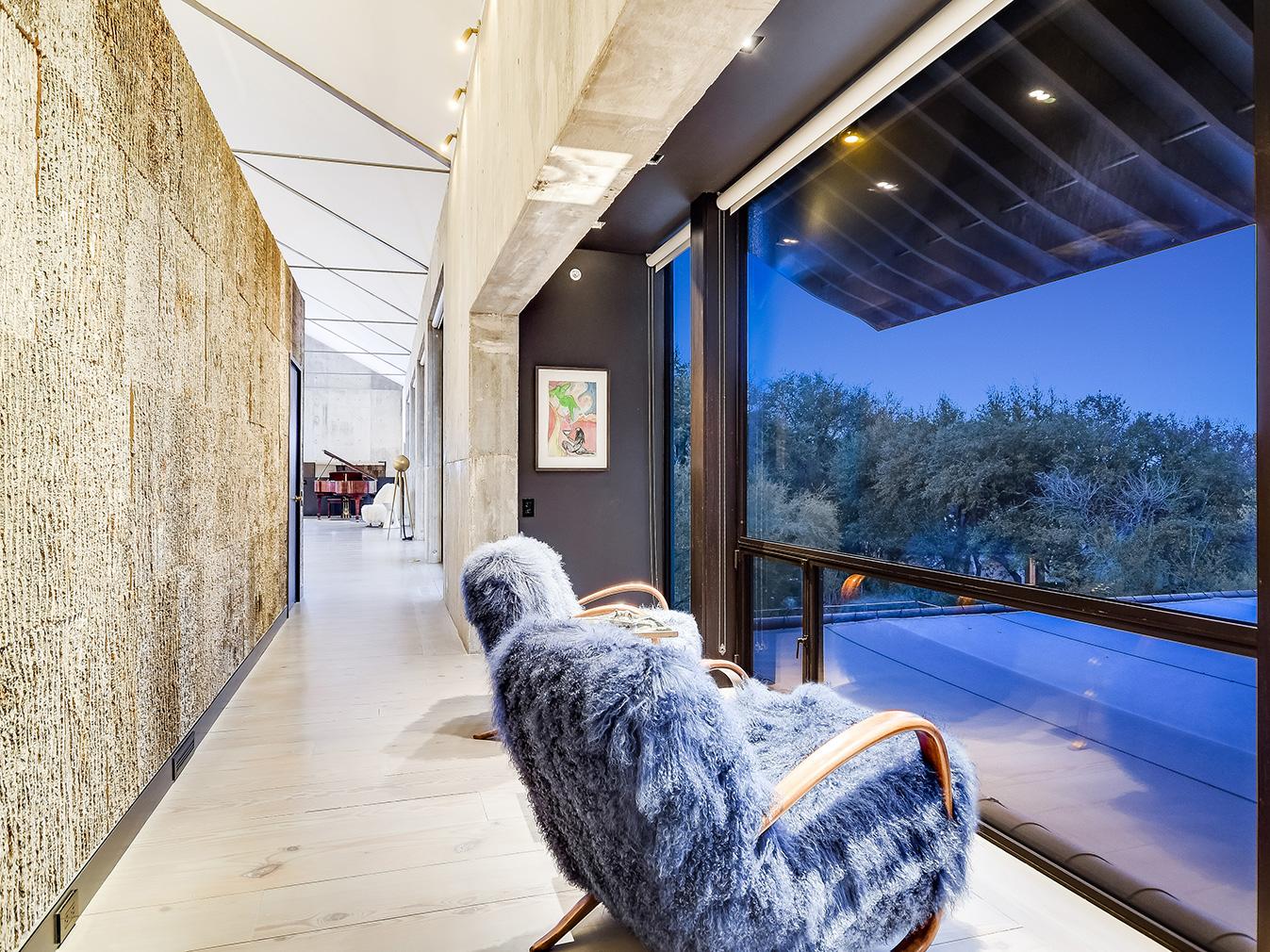 A writer's brutalist Austin estate blends barn and loft living