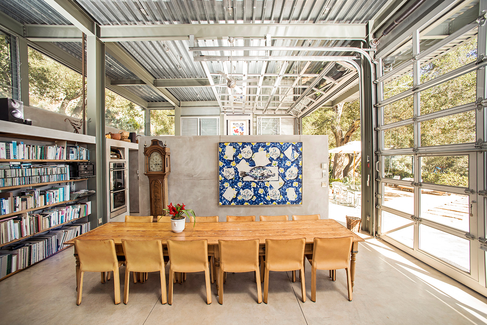 Inside Barton Myers' industrial Santa Barbara home. It feautres rolling garage door walls that open to the elements, as well as a fixed steel-beam frame and corrugated steel roof.