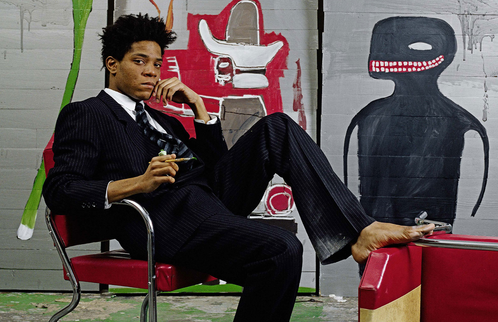 A barefoot Jean-Michel Basquiat wearing Giorgio Armani