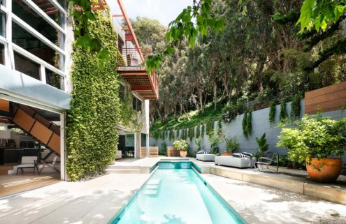 Free-flowing Santa Monica home unfurls around a zig-zag staircase