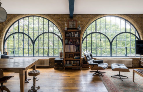 Industrial windows steal the show inside this London loft