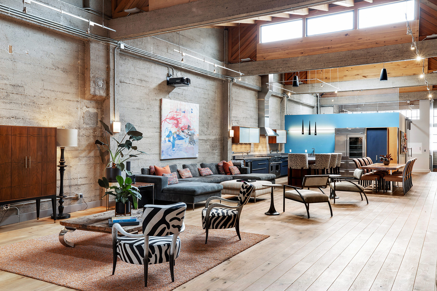 Stacked shipping containers sit inside this sprawling warehouse loft in San Francisco's Fillmore District, juxtaposing industrial brick bones with rugged steel.