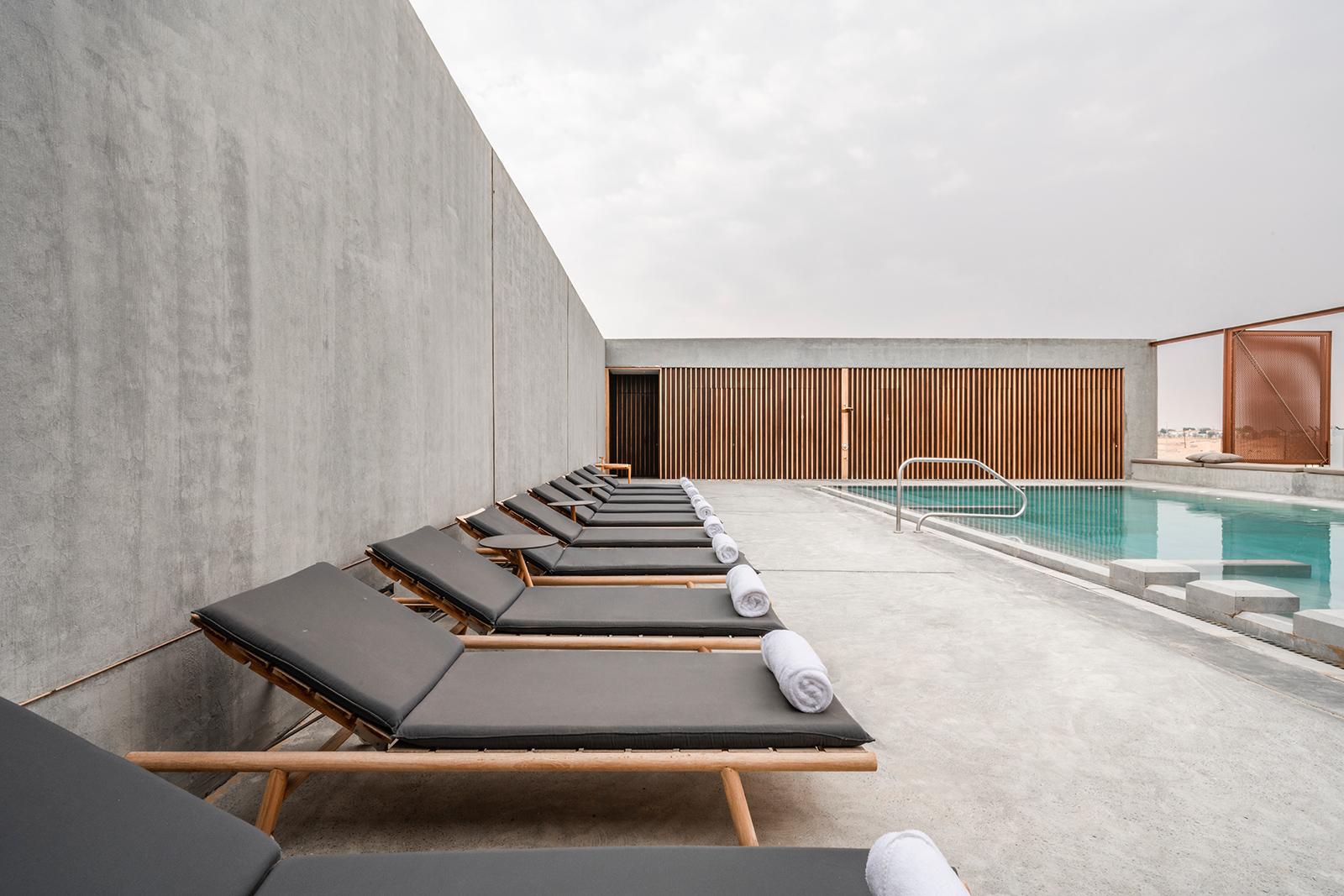 The concrete swimming pool and area at Al Faya Lodge, UAE