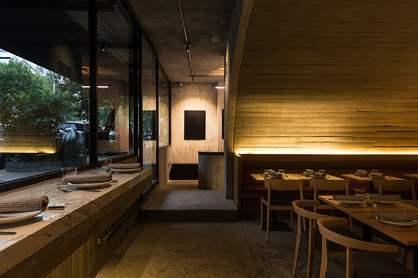 Sartoria offers a contemporary take on Europe's vaulted taverns, serving fresh pasta inside a glowing concrete tunnel in Mexico City's Roma Norte neighbourhood.