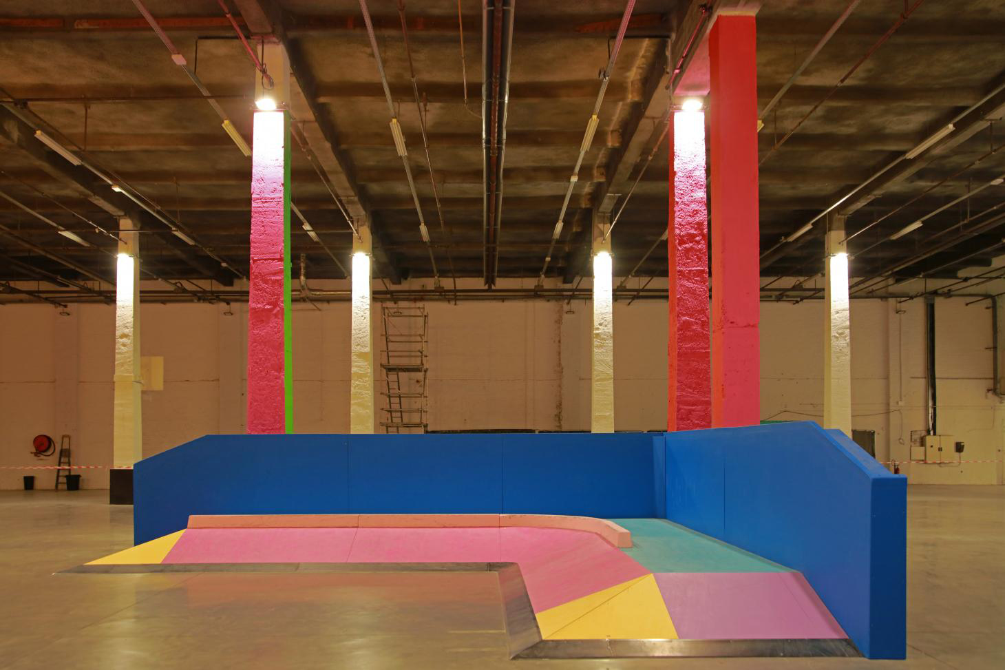 Golden columns and fluorescent paint helped Yinka Ilori turn Roubaix's Halle B warehouse into the Colorama Skatepark.