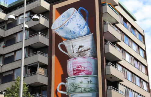 Teacups spill out of a Helsingborg building in Leon Keer's latest artwork