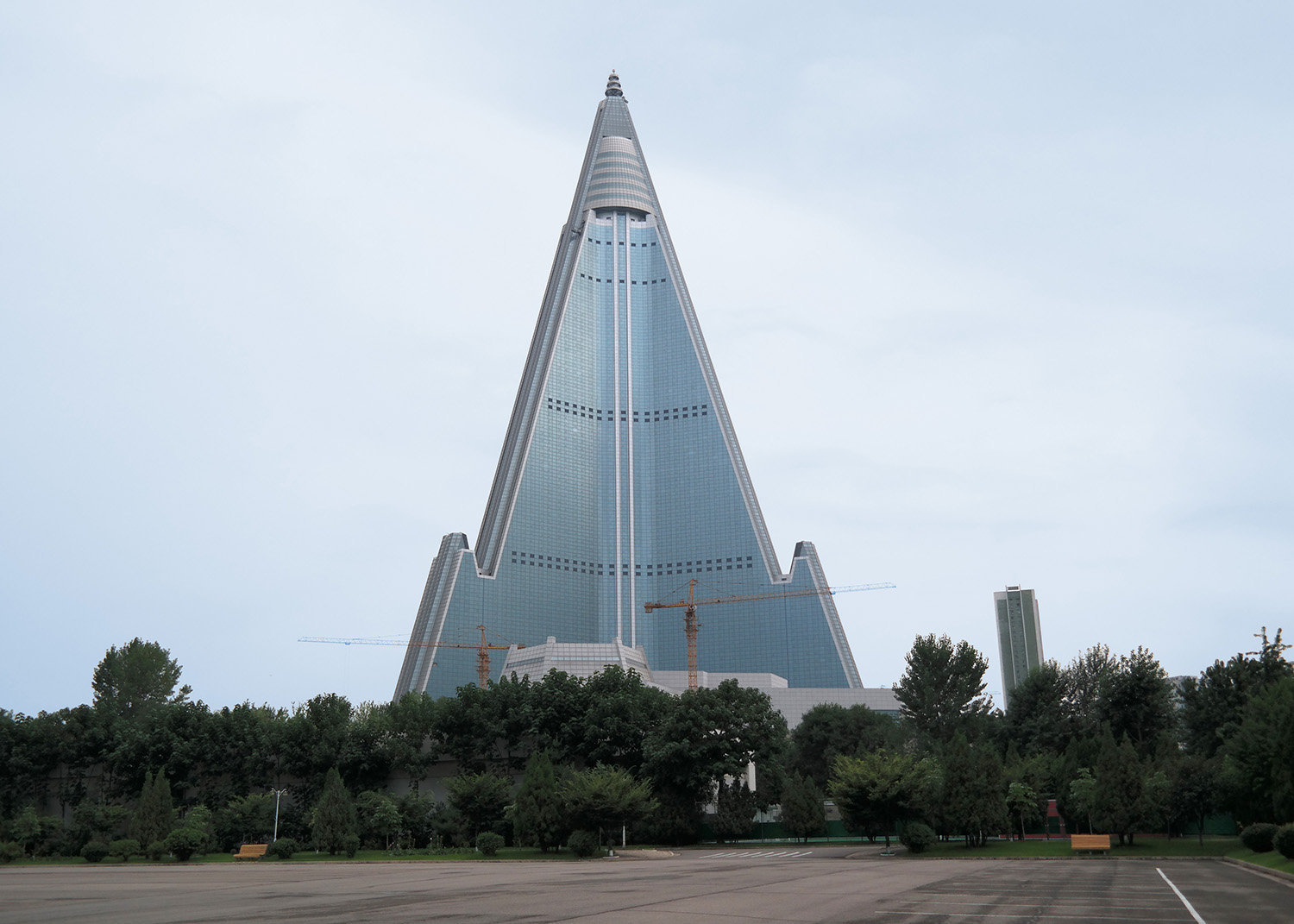 Ryugyong Hotel, aka The Hotel of Doom. Its construction began in 1987 – it is still incomplete 33 years later