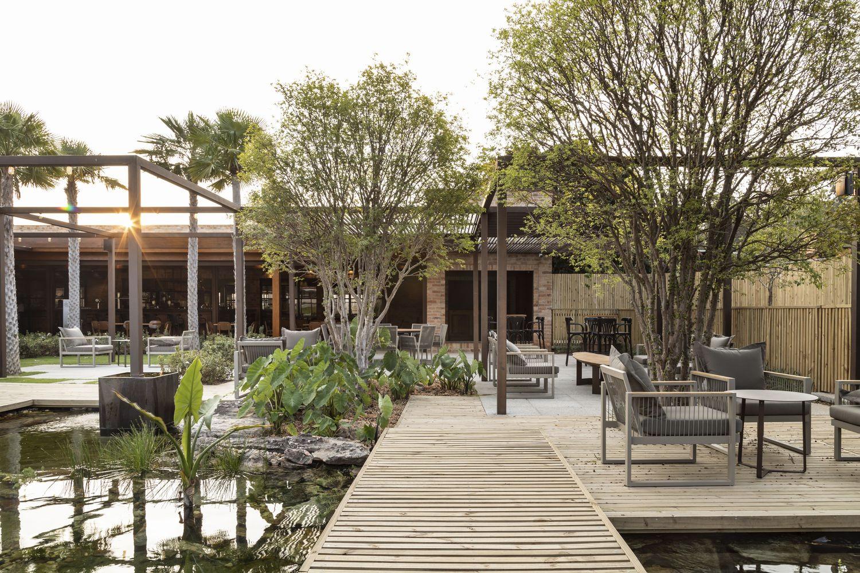 Diners are enveloped in lush gardens at São Paulo restaurant Origem 75