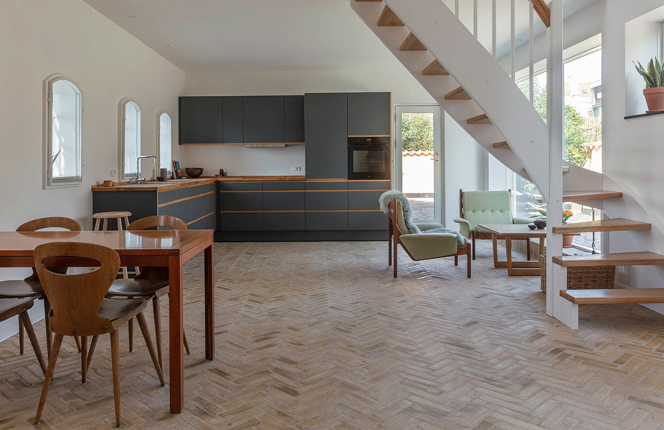 An architect's studio is now a modern home on Lake Gentofte's shores following a gentle renovation to polish its historic bones
