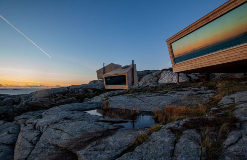 Flokehyttene cabins perch on a rocky headland in western Norway
