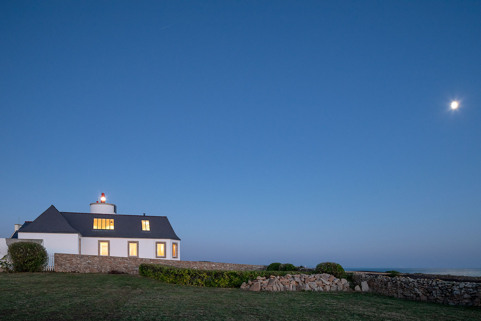A converted semaphore station and lighthouse perches on the rocky Breton coast