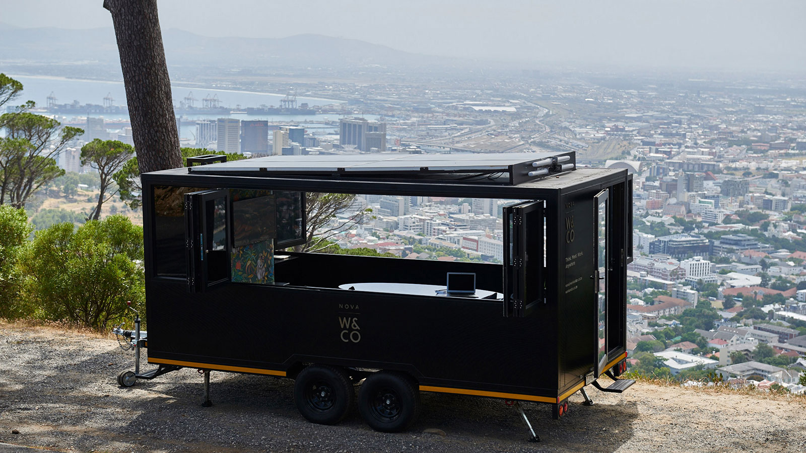 Nova nomadic coworking pod in South Africa. It can be hitched to the back of a truck and towed wherever there are roads, with solar power providing electricity to power laptops