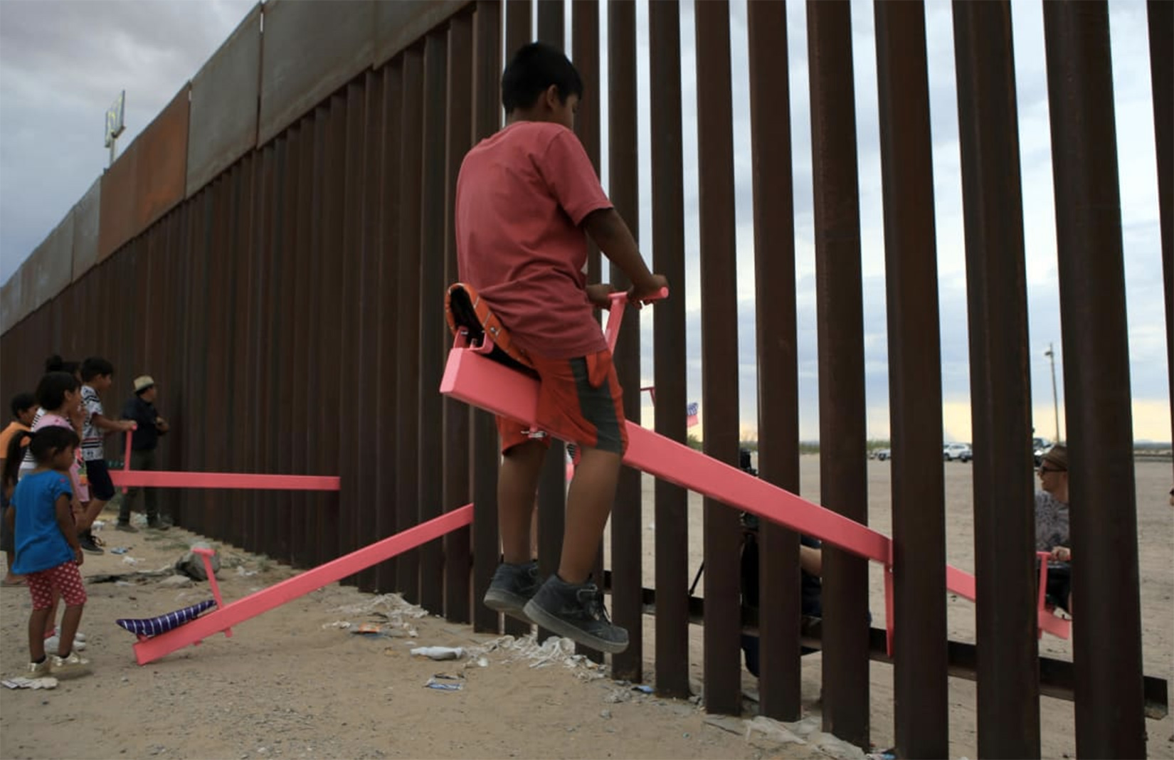 Teeter-Totter Wall - a see-saw installation at the US-Mexico border by studio Rael San Fratello. The temporary interactive installation was awarded the 2020 Beazley Design of the Year. Photography: Luis Torres