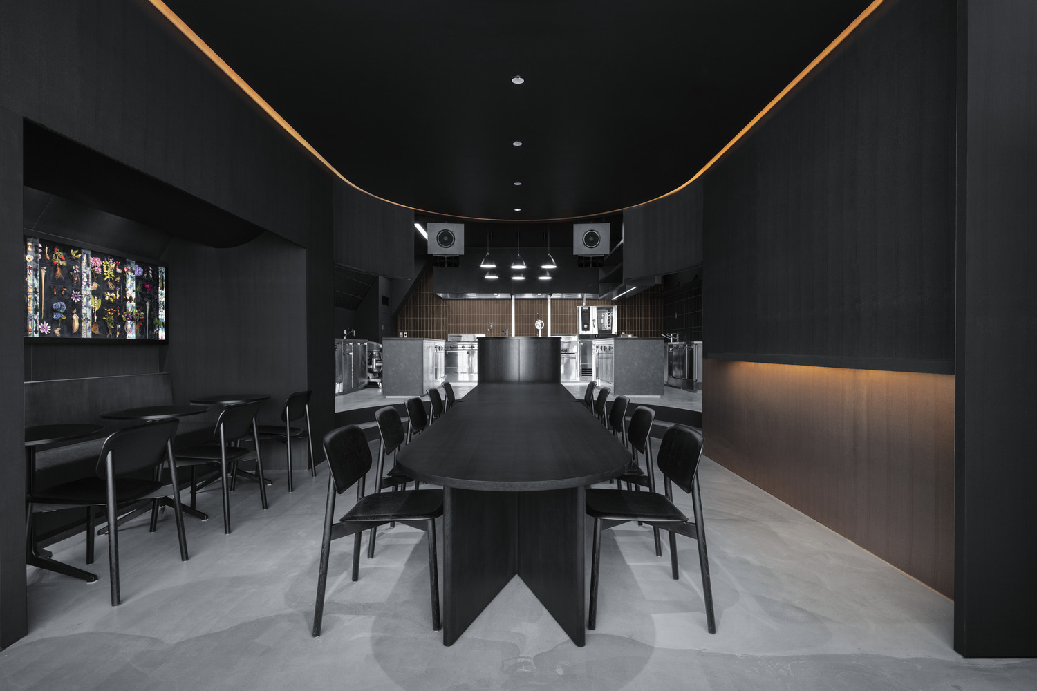 The corner stores of New York and the conbinis of Tokyo combine at this all-black cafe and restaurant – which is Snøhetta's first project in the Japanese capital.