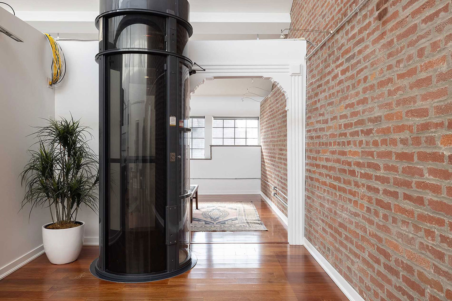 Arched doorways and floating walls help divide the apartment while retaining its soaring height