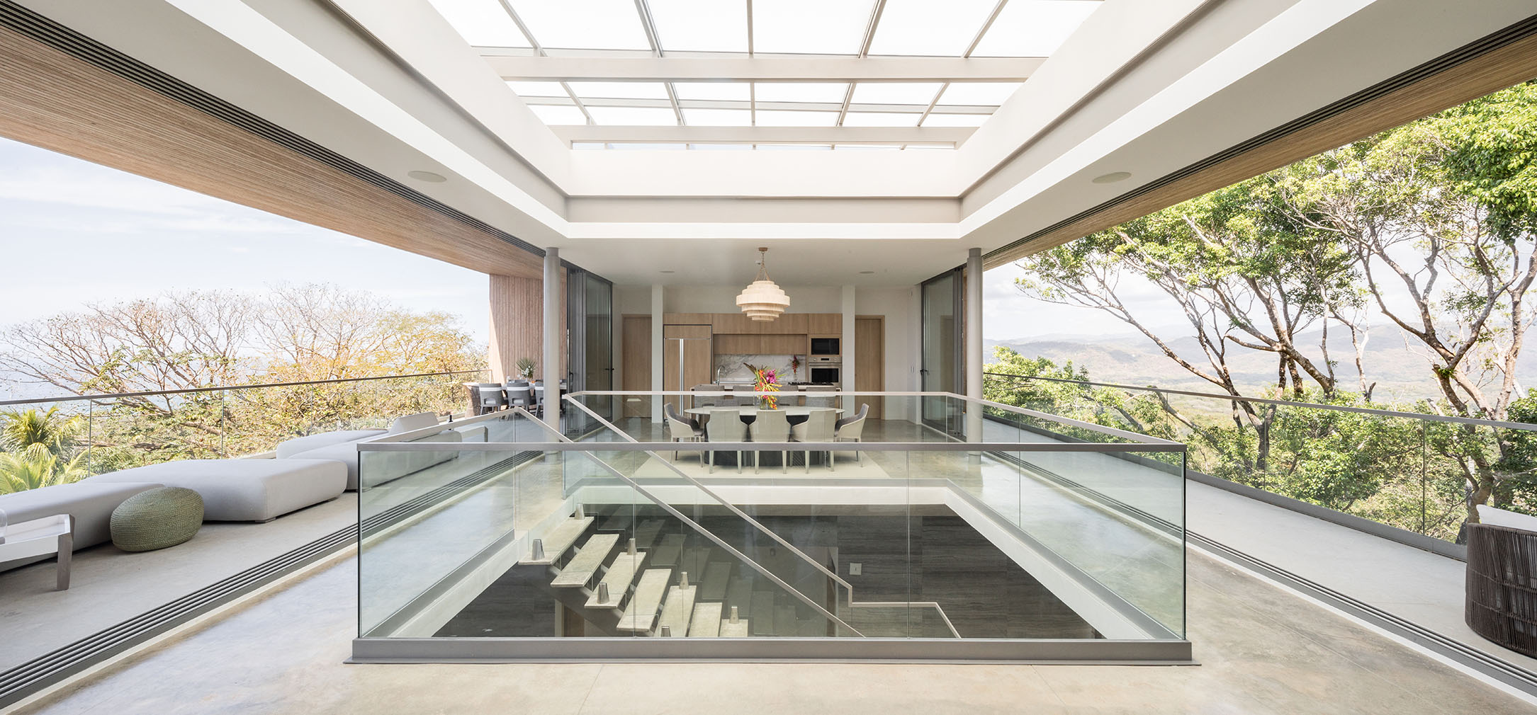 Three levels are connected by a glass-enclosed staircase atrium, which helps direct air flow through the home